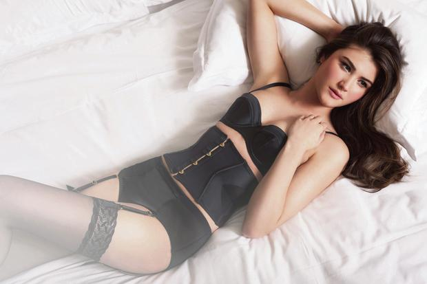Black bra, €63, waspie, €120, and briefs with |suspenders, €48, |all L'Agent by Agent |Provocateur; black |stockings, €15, Falke