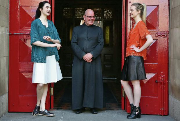 Models Maria Oxley Boardman and Rebecca O'Keeffe (right), with Fred Deane, caretaker of St Anne's church, Dawson Street, Dublin