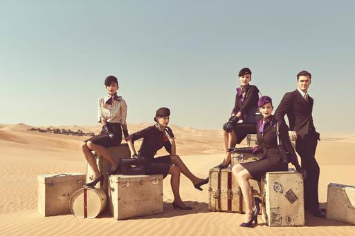 High flying: The slimline skirt is the star of Ettore Bilotta's new uniform for Etihad Airways cabin crew, pictured by Vogue and Vanity Fair photographer Norman Jean Roy in Abu Dhabi's Liwa desert