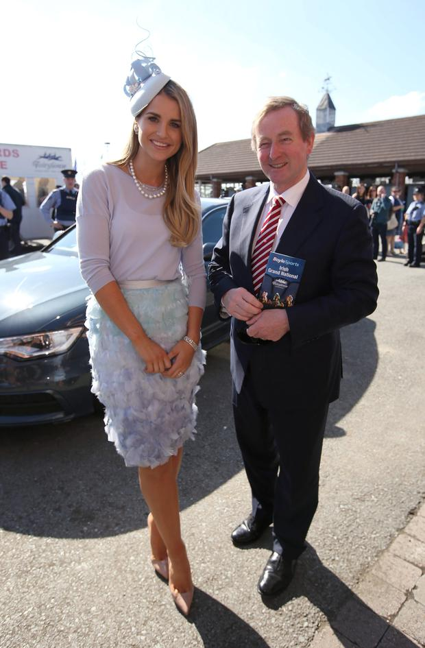 Taoiseach Enda Kenny with model, Vogue Williams, who judged the most stylish lady at the Fairyhouse Easter Festival