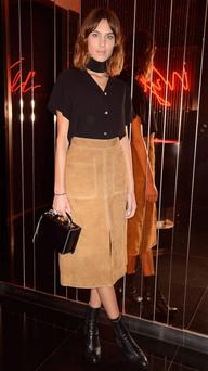 Alexa Chung stepped out in the calf-length skirt.