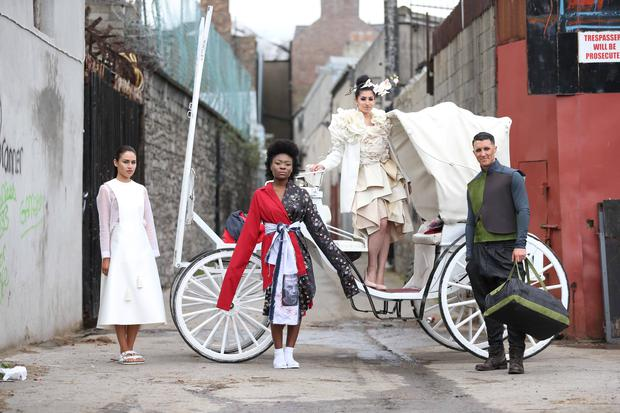 First place went to 'Fauna' by Griffith College student Lamis Goumaa from Kimmage, Dublin, modelled by DIT student Nick Marnitz (right), from Cabinteely, Dublin. Second place for 'Oriental Blossom' by Grafton Academy student Shauna Harrison, from Newtownmountkennedy, Co Wicklow, whose design is modelled by DIT student Eda Nur (left) from Lucan, Co Dublin. Joint second was 'We are the flowers in your dustbin' by Limerick School of Art and Design student Mollie Sinnott, from Gorey, Co Wexford, modelled by DIT student Nagel Nash (second from right) from Rathmines, Dublin