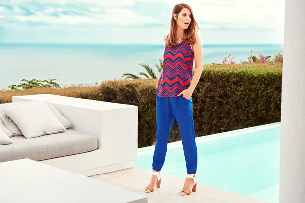 Red and blue printed vest, €9.97, cuffed hem trousers, €18, stack heel sandals, €20