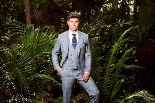 The Christian three-piece light grey suit with powder blue overcheck and double-breasted eight-button waistcoat, €1,095; Louis Copeland slim-fit shirt, €129; tie, €59.95; pocket square, €29.95; Eaton tie clip, €109