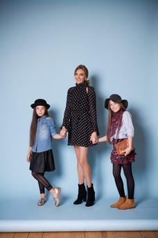 Ingrid Hoey with Freya (11) and Milla (8). Photo: Naomi Gaffey