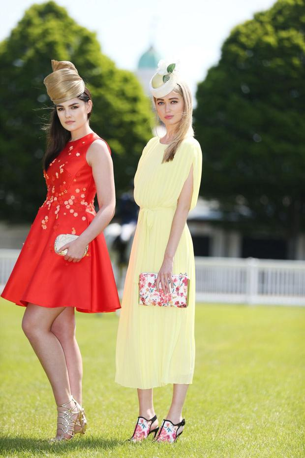 Red skater dress, €325, Karen Millen; sandals, €80 and clutch, €60, Aldo; turban, €60 to rent from Hat Society. Lime midi dress, €102, Warehouse; shoes, €210 and bag, €130, Karen Millen; headpiece, €60 to rent, Hat Society.