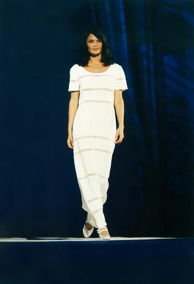 1996: Supermodel Helena Christensen wears silk morocain and chiffon sleeve dress.