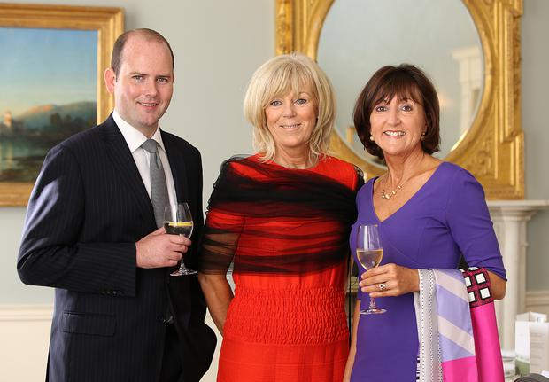 Garrett Power, the hotel manager, welcomed guests including Kathryn Tunney and Dorothy McCann. Photo: Frank McGrath Jr