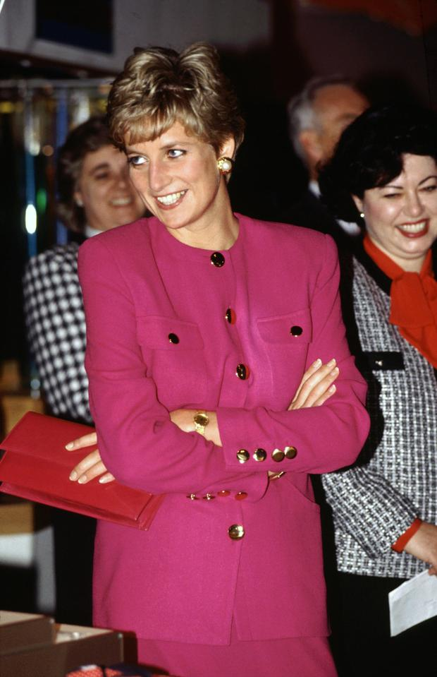 Diana, Princess of Wales, smiling during her visit to Sudbury, part of her official tour of Canada, in 1991. The Princess is wearing a pink suit designed by fashion designer Paul Costelloe (Photo by Tim Graham/Getty Images)