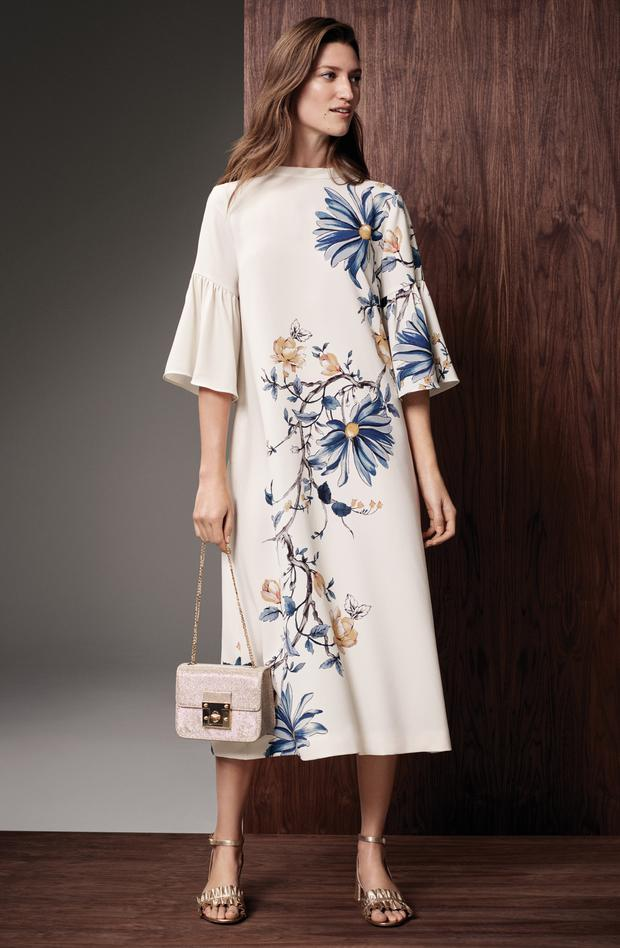 M&S Collection floral dress with statement sleeve, €60; bag, €35; and gold ruffle sandals, €60.