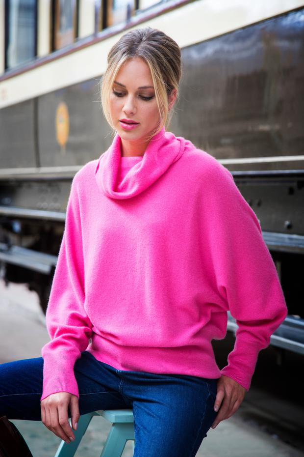 Pink cashmere cowl neck jumper, €140 (available early September); jeans, €60 (available early September), Paul Costelloe Living Studio exclusively for Dunnes Stores