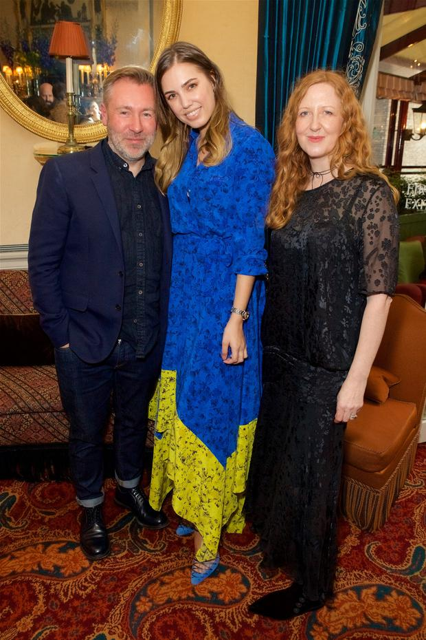 Bright and beautiful: Justin Thornton, Thea Bregazzi and Amber Le Bon, centre, who wears the pair's 100pc silk dress (€330), at the launch of the Studio By Preen capsule dress collection in Mayfair, London this month