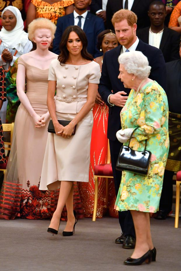 Meghan has stepped out in asymmetric hems on numerous occasions, from the navy Roland Mouret she wore the night before her wedding to the double-breasted Prada skirt suit at last week's awards ceremony with the Queen. Photo: Getty Images