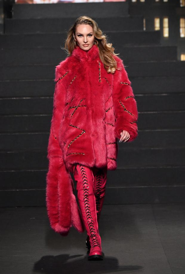 125ecc595a Candice Swanepoel wore a pink faux fur coat at the global launch. Photo:  Getty
