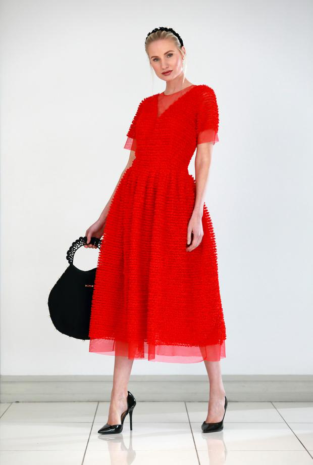 Red confetti dress with tulle underskirt, €950, worn with pearl-embellished hairband and black bag, both to order from Sarah Murphy, sarahmurphy.com