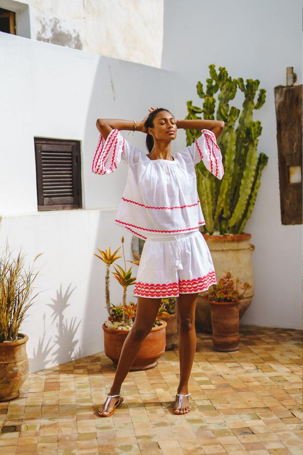 White top in 100pc cotton voile with pink and orange embroidery, €185; shorts in 100pc cotton poplin with drawstring waist and matching embroidery, €157