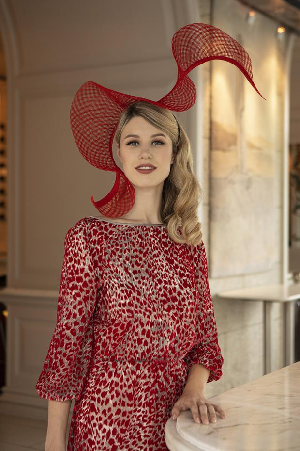 Red swirl hat in window-pane straw, €65 to hire, Laura Hanlon; red devoré dress with V back, €299, Fee G