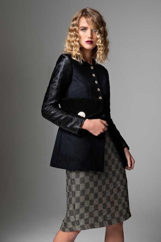 Melton wool short coat with pleated eco leather sleeves, €400; gold and black checkerboard skirt, €250