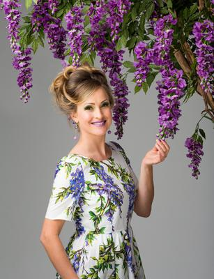 Leonie Cornelius in Dolce & Gabbana 'Wisteria' dress, €950, Brown Thomas, Grafton Street; Vivien Walsh violet jade drop earrings, €45, Kilkenny, Nassau Street, kilkennyshop.com; Wisteria tree, €137.40, Outdoor Scene, outdoor.ie