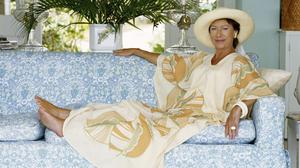 Princess Margaret reclining on a sofa at her home, Les Jolies Eaux, on Mustique in the West Indies in April 1976. (Photo by Lichfield Archive via Getty Images).