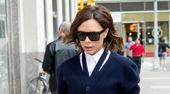 Deconstructed take: Victoria Beckham donned a cardigan with collar detailing