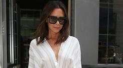 Look to Victoria Beckham on how to style a midi for the office with smart courts. Photo: GC Images