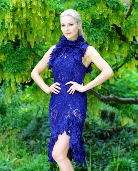 1st Option model Teo Sutra wears a sheer lace dress in midnight blue (€699), a made to order look from Lya Solis's pre-Autumn Winter Collection, unveiled yesterday