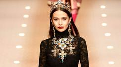 A Dolce & Gabbana model dons a jewel-encrusted cross necklace and crown. Photo: AFP/Getty Images