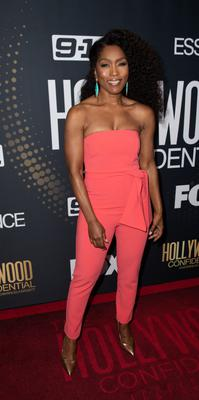 For evening, look to Angela Bassett  in a strapless coral jumpsuit for left-field Hollywood glamour