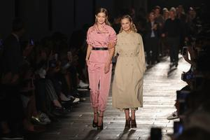 Gigi Hadid (L) and Lauren Hutton modelled trench coats at Bottega Veneta