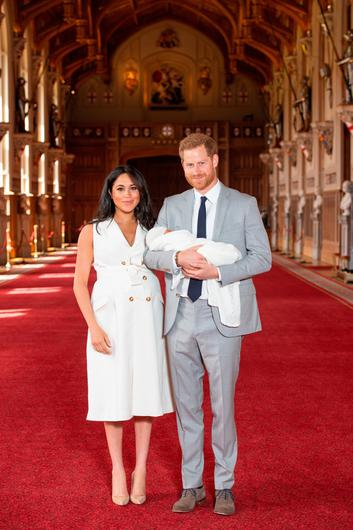 Meghan Markle wore a coat dress to show off her newborn son with Prince Harry. Photo: Getty Images