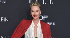Look to Charlize Theron and throw a blazer on top. Photo: Getty Images