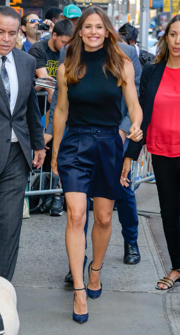 For the office, tailored shorts can be your summertime substitute for slacks, as evidenced by Jennifer Garner in a sleek navy pair. Photo: GC Images