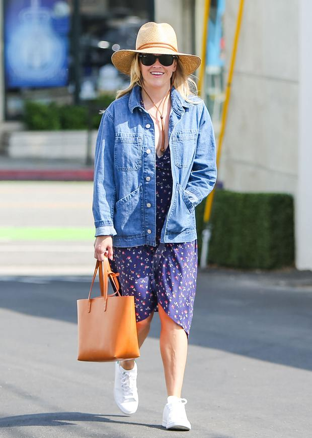 If that feels too dressy for everyday, go for the trusted denim jacket. It's a classic for good reason, and a year-round favourite of Reese Witherspoon. Photo: GC Images