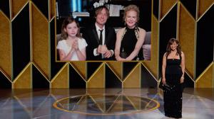 Nicole Kidman, nominee for best actress in a limited series for The Undoing appears on screen with her husband Keith Urban and their daughter Faith Margaret Kidman Urban as presenter Rosie Perez looks on at the Golden Globe Awards. (Photo: NBC via AP)
