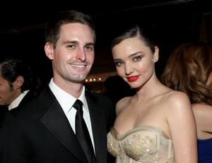 Falling for intelli-gents: Miranda Kerr with Snapchat co-founder Evan Spiegel