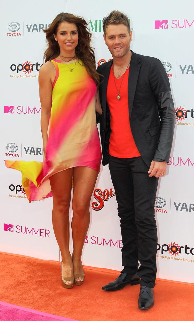 Vogue Williams, pictured with Brian McFadden, stood out from the crowd at a summer party in Sydney in 2011