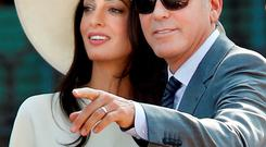 George Clooney and Amal Alamuddin at the Cavalli Palace for the civil marriage ceremony in Venice