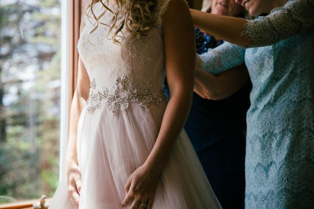 Bride getting ready on wedding morning | Photo by Heather Miller