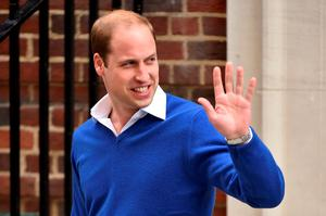Britain's Prince William, Duke of Cambridge, waves as he leaves the Lindo Wing at St Mary's Hospital in central London, on May 2, 2015 where his wife Catherine, Duchess of Cambridge, gave birth to their second child, a baby girl, earlier in the day. The Duchess of Cambridge was safely delivered of a daughter weighing 8lbs 3oz, Kensington Palace announced. The newly-born Princess of Cambridge is fourth in line to the British throne.  AFP PHOTO / BEN STANSALLBEN STANSALL/AFP/Getty Images
