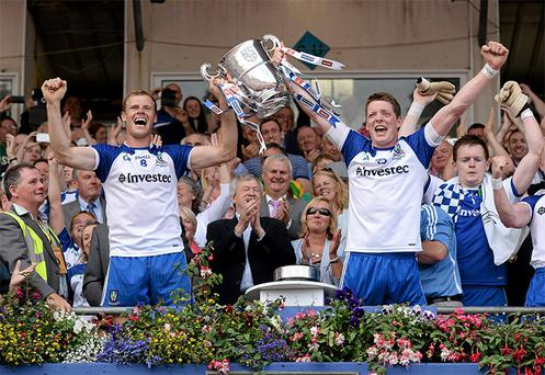 Owen Lennon and Conor McManus, Monaghan, hold aloft the Anglo Celt cup after the game