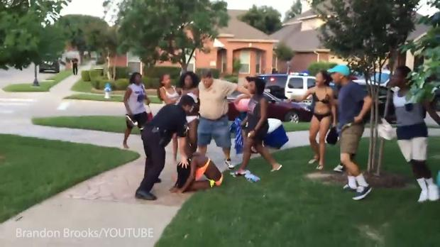 The officer was filmed pushing the 14-year-old's face into the ground Credit: Brandon Brooks
