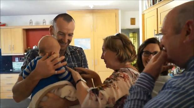 The moment John O'Regan introduces his parents to their grandson for the first time