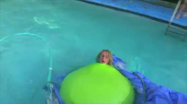 Jack Tenny struggles to keep his head above water as the giant balloon topples over mid stunt