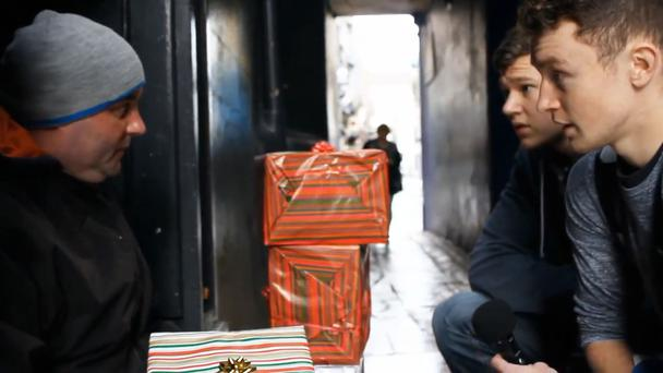 The teenagers walked around the capital handing out packages to those in need.