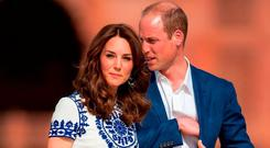 The Duke and Duchess of Cambridge stand after posing for a photo on a bench at the Taj Mahal, in Agra, India during day seven of the Royal tour to India and Bhutan. PRESS ASSOCIATION Photo. Picture date: Saturday April 16, 2016. See PA story ROYAL India. Photo credit should read: Dominic Lipinski/PA Wire