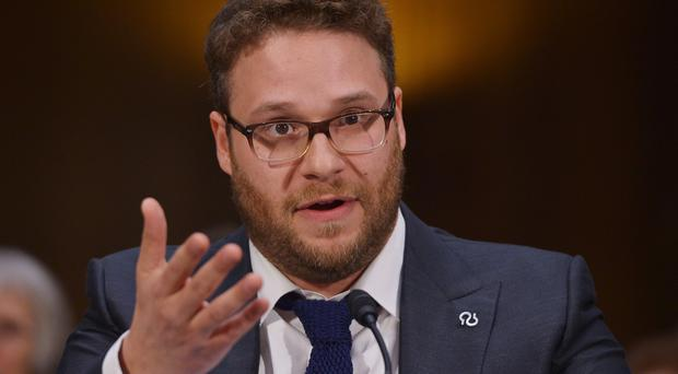 Actor and Alzheimer's advocate Seth Rogen testifies before the Senate Committee on Appropriations on the rising cost of Alzheimer's in America on February 26, 2014 in the Dirksen Senate Office Building on Capitol Hill in Washington, DC. AFP PHOTO/Mandel NGANMANDEL NGAN/AFP/Getty Images