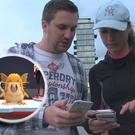 Kevin Donoghue and his girlfriend Linda Barber see what pokemon they can find around Grand Canal Dock.