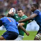 13 February 2016; Robbie Henshaw, Ireland, is tackled by Virimi Vakatawa, left, and Yacouba Camara, France. RBS Six Nations Rugby Championship, France v Ireland. Stade de France, Saint Denis, Paris, France. Picture credit: Brendan Moran / SPORTSFILE