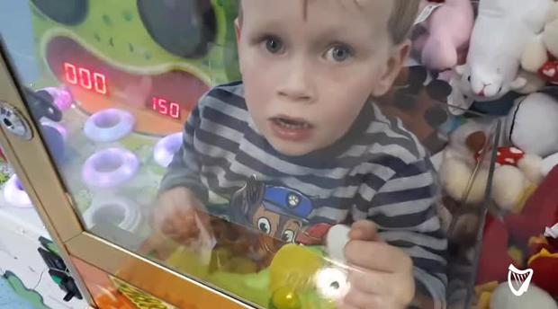 Mischievous toddler climbs into toy machine to grab himself a prize